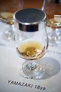 Yamazaki, November 22 2011 - Suntory whisky distillery in Yamazaki, Japan. A glass of 18 year Yamazaki whisky before the tasting.