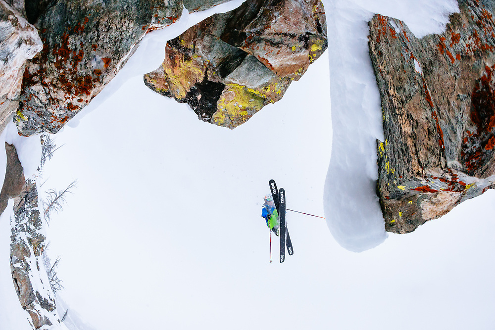 Tanner Flanagan skiing blower powder and grabbing a 360 rotation off of a lichen covered rock band in the  Teton backcountry near Jackson Hole Mountain Resort in Teton Village, Wyoming.