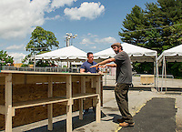 Tyler Glover and Todd Ahrend talk about construction of the bar area for Laconia Fest beginning this Saturday at the Weirs Beach Drive In Theater during Motorcycle Week 2016.  (Karen Bobotas/for the Laconia Daily Sun)