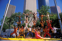 Stock photo of a group doing an acrobatic performance at the International Festival in downtown Houston Texas