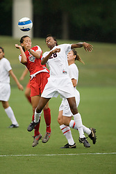 New Mexico Lobos MF Terryn Granados (21) wins a header from Arizona Wildcats MF/F Jasmin Day (28)...The New Mexico Lobos faced the Arizona Wildcats in the first game of the 2007 Nike Soccer Classic held at Klockner Stadium in Charlottesville, VA on August 14, 2007.  The Wildcats defeated the Lobos 4-1.