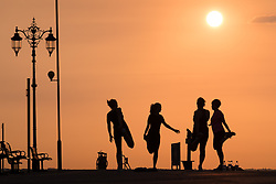 © Licensed to London News Pictures. 15/09/2016. Portsmouth, UK. A group of women stretching Southsea Promenade warming down after a morning jog as the sun rises this morning, 15th September 2016. Photo credit: Rob Arnold/LNP