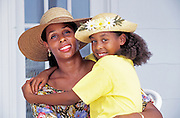 African American mother and daughter portrait on their front porch