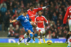 LONDON, ENGLAND - Saturday, January 9, 2010: Everton's captain Tim Cahill and Arsenal's Abou Diaby during the Premiership match at the Emirates Stadium. (Photo by David Rawcliffe/Propaganda)