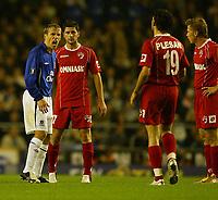 Photo: Aidan Ellis.<br /> Everton v Dinamo Bucuresti. UEFA Cup. 29/09/2005.<br /> Everton's Phil Neville shouts at Dinamo's Mihiatia Plesan after a bad challenge on Mikkael Arteta