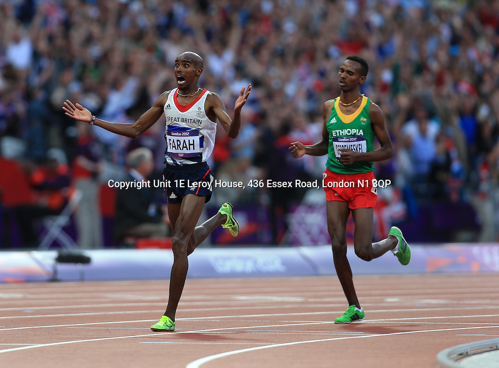 11th August 2012 - London 2012 Olympic Games - Athletics - Men's 5,000m Final - Mo Farah (GBR) celebrates as he crosses the line ahead of Dejen Gebremeskel (ETH) - Photo: Simon Stacpoole / Offside.