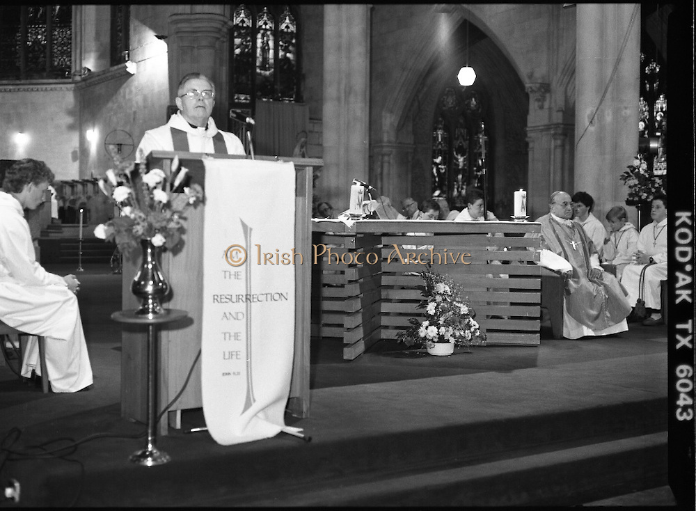 Mass For Edel Quinn.  (S3)..1989..13.05.1989..05.13.1989..13th May 1989..A special mass was held in Saint Saviour's Priory,Dominick Street,Dublin, in remembrance of Edel Quinn. Edel Quinn was a major driving force in The Legion of Mary. Edel Quinn was appointed as special envoy to work in Africa and up until her death in Nairobi,from TB, in 1944 she promoted the values of the Legion throughout Africa. The Papal Nuncio, Emanuele Gerada was in attendance at the mass...Image shows  a view of the altar with Papal Nuncio, Emanuele Gerada on the right as a lesson is read by one of the co-celebrants.
