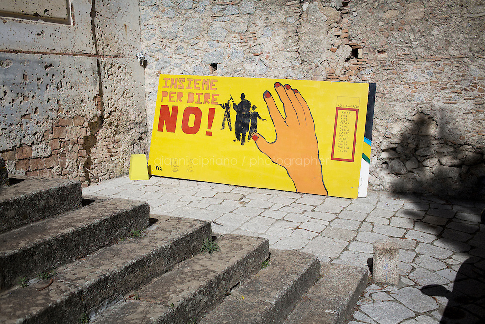 RIACE, ITALY - 24 October 2013: A mural against the 'Ndrangheta, the organized crime of Calabria, in Riace, Italy, on October 24th 2013.
