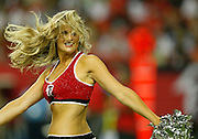 ATLANTA - AUGUST 29:  An Atlanta Falcons cheerleader performs a routine during a first half break during the game against the San Diego Chargers at the Georgia Dome on August 29, 2009 in Atlanta, Georgia.  The Falcons beat the Chargers 27-24.  (Photo by Mike Zarrilli/Getty Images)