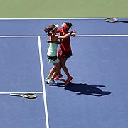 Martina Hingis, Switzerland and Sania Mirza, India, winning the Women's Doubles Final against Casey Dellacqua, Australia and Yaroslava Shvedova, Kazakhstan, during the US Open Tennis Tournament, Flushing, New York, USA. 13th September 2015. Photo Tim Clayton