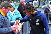 Nathan Ake (5) of AFC Bournemouth signs a fans football as he arrives before the Premier League match between Bournemouth and West Ham United at the Vitality Stadium, Bournemouth, England on 19 January 2019.