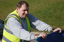 Man with a mild learning disability working as a factory cleaner, shown here pushing trolley, helped into employment by the Ready 4 Work team, Nottinghamshire County Council