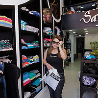 A Palestinian young woman buy clothes in trendy shopp of Ramallah...Photo by Olivier Fitoussi.