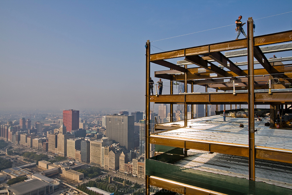 Ironworker Jeff Devine (at top) at work at a construction site on 300 East Randolph St., Chicago, Illinois. (Jeff Devine is featured in the book What I Eat: Around the World in 80 Diets.) MODEL RELEASED.