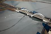 Nederland, Noord-Holland, Amsterdam, 10-01-2009; IJburg: Enneus Heermabrug naar stadsdeel IJburg, Buiten-IJ; ijsveld met spoor van schip wat (nog) door het ijs gevaren is; ice-field in the northeast part of Amsterdam, trace of ship sailing trough ice; ijsschots, ijsveld, veld, schots, schotsen, ijsgang, ijs, natuurijs, winter, koud, vriezen, min nul, beneden nul, koud, celsius, ice, snow, cold, freezing, minus zero, below zero, cold, winterlandschap, winter landscape. .luchtfoto (toeslag); aerial photo (additional fee required); .foto Siebe Swart / photo Siebe Swart