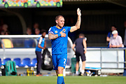 AFC Wimbledon defender Barry Fuller (2) with hand on chest during the EFL Sky Bet League 1 match between AFC Wimbledon and Doncaster Rovers at the Cherry Red Records Stadium, Kingston, England on 26 August 2017. Photo by Matthew Redman.