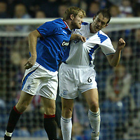 Rangers v St Johnstone....03.12.03<br />Egil Ostenstad gets shirty with Ian Maxwell<br /><br />Picture by Graeme Hart.<br />Copyright Perthshire Picture Agency<br />Tel: 01738 623350  Mobile: 07990 594431