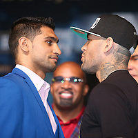 Boxer Amir Khan (left) faces off  with opponent Luis Collazo during the undercard final press conference for the Mayweather & Maidana boxing match at the Hollywood Theater, inside the MGM Grand hotel on Thursday, May 1, 2014 in Las Vegas, Nevada.  (AP Photo/Alex Menendez)