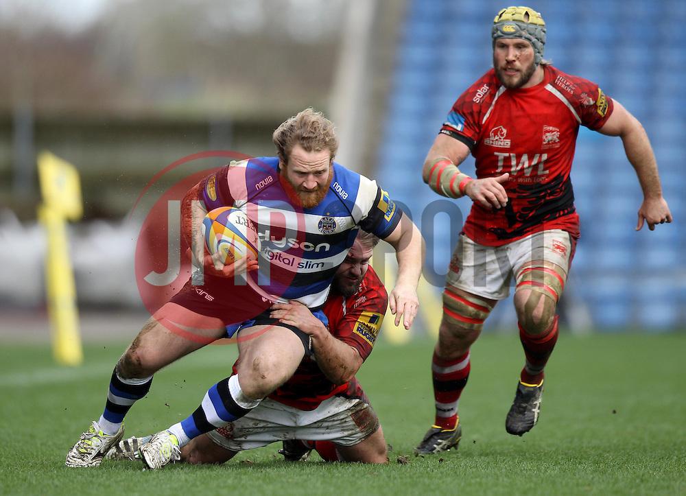 Bath's Ross Batty is tackled - Photo mandatory by-line: Robbie Stephenson/JMP - Mobile: 07966 386802 - 29/03/2015 - SPORT - Rugby - Oxford - Kassam Stadium - London Welsh v Bath Rugby - Aviva Premiership