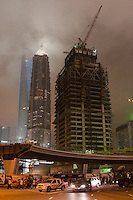 night view of skyscraper under construction in Shanghai China