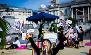 UNITED KINGDOM, London:  Christian Aid, takes part in a campaign to increase pressure on David Cameron and other world leaders to clamp down on tax dodging. Trafalgar Square was turned into a tropical 'tax haven' this morning as volunteers dressed in business suits and bowler hats organised by Oxfam, ActionAid and Christian Aid, on May 12, 2016. Pic by Andrew Cowie / Story Picture Agency