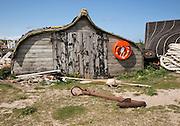 Upturned boat used as storage shed, Holy Island, Lindisfarne, Northumberland, England, UK