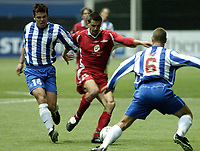 Fotball, Royal League, 17 feb 2005, Brann - Odense, 2-1, Paul Scharner, Brann og Alexander Aas, Esben Hansen, Odense.