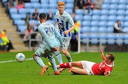 Bristol City's Aaron Wilbraham tackles Coventry City's Jordan Clarke  - Photo mandatory by-line: Joe Meredith/JMP - Mobile: 07966 386802 - 18/10/2014 - SPORT - Football - Coventry - Ricoh Arena - Bristol City v Coventry City - Sky Bet League One