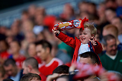 BLACKBURN, ENGLAND - Thursday, July 19, 2018: A young Liverpool supporters on the shoulders of a man during a preseason friendly match between Blackburn Rovers FC and Liverpool FC at Ewood Park. (Pic by Paul Greenwood/Propaganda)