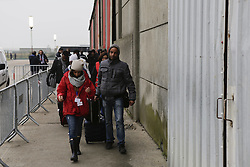 October 24, 2016 - Calais, Nord-Pas-de-Calais-Picardie, France - Refugees walk in the Reception and Orientation Centre at the Jungle to the next step in the registration. The first day of the registration and distribution of the refugees from the Jungle in Calais has seen 1631 refugees in 39 buses have been distributed by 16:00 to several places in France. (Credit Image: © Michael Debets/Pacific Press via ZUMA Wire)