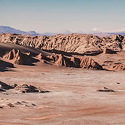 The Atacama Desert in Northern Chile is a sublime place. It is the driest place on earth and there is literally little to no life there. Even birds avoid flying over it as they cannot come down for water, so they avoid it. This scene was taken after hiking up one of the huge dunes in the moon valley. The road you see in the foreground (left) takes travellers deep into the desert. The scene is unlike any other I have seen before.