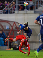 TRNAVA, SLOVAKIA - Thursday, October 10, 2019: Wales' Kieffer Moore is fouled by Slovakia's Norbert Gyömber, which resulted in the Sloivakian being sent off for a second yellow card during the UEFA Euro 2020 Qualifying Group E match between Slovakia and Wales at the Štadión Antona Malatinského. (Pic by David Rawcliffe/Propaganda)