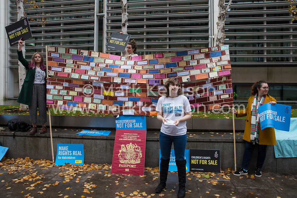 London, UK. 25 November, 2019. Campaigners from Amnesty International UK's Children's Human Rights Network and PRCBC protest outside the Home Office to call on the British Government to stop selling children's rights. Currently, the Home Office charges £1,012 for citizenship applications, including for children living in poverty or local authority care, whilst the cost of processing an application is £372. Thousands of children with rights to British citizenship are prevented from claiming their rights due to excessive fees.