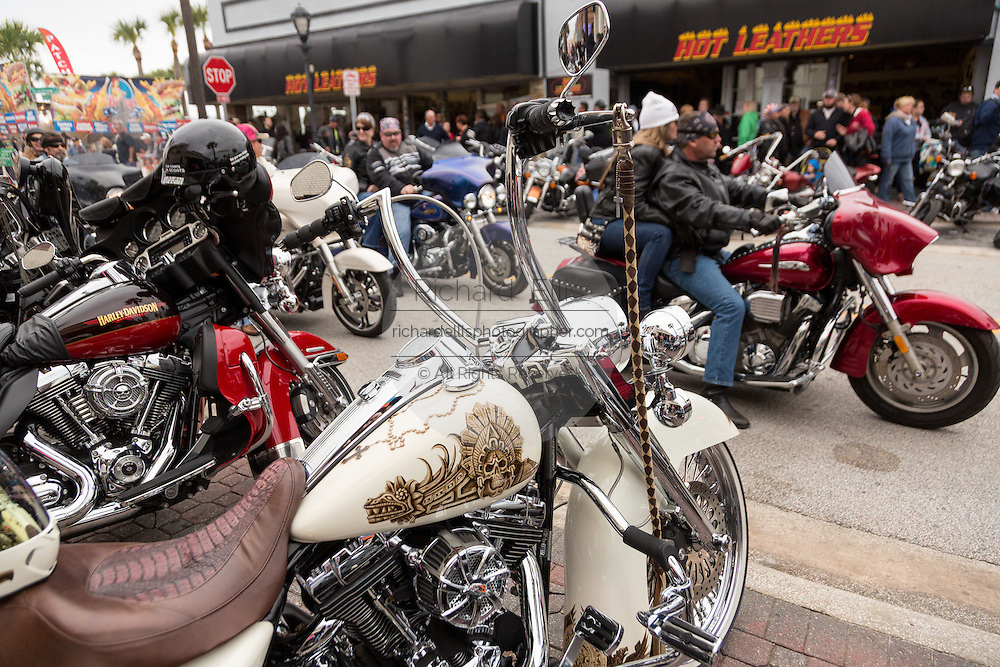 Leather clad bikers ride down Main Street past custom painted Harley-Davidson bikes during the 74th Annual Daytona Bike Week March 7, 2015 in Daytona Beach, Florida.