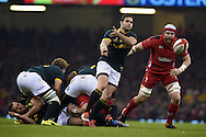 South Africa's Cobus Reinach passes the ball. Dove Men series 2014, autumn international rugby match, Wales v South Africa at the Millennium stadium in Cardiff, South Wales on Saturday 29th November 2014<br /> pic by Andrew Orchard, Andrew Orchard sports photography.
