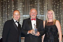 CARDIFF, WALES - Monday, October 8, 2012: Peter Rodrigues receives the Service Award from Wales' Chief-Executive Jonathan Ford and ATPI Travel's Shelley Matthews during the FAW Player of the Year Awards Dinner at the National Museum Cardiff. (Pic by David Rawcliffe/Propaganda)