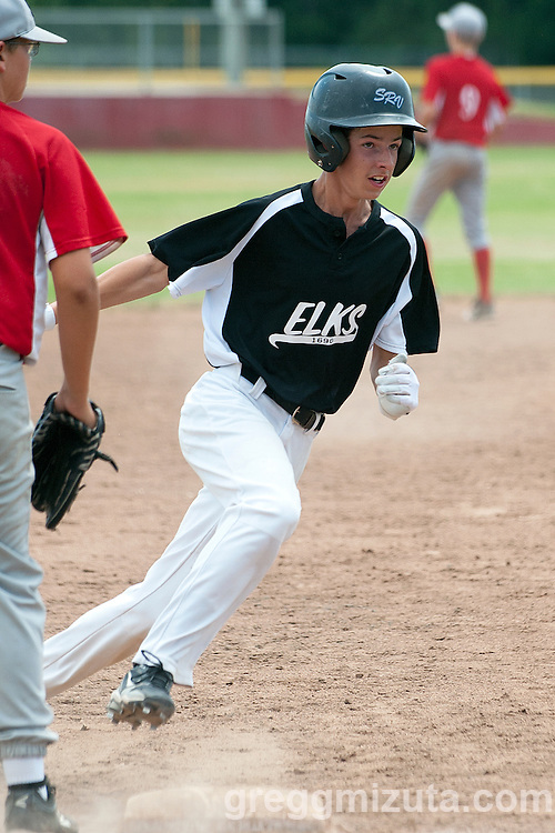 Trevor Fugate rounds third during the Vale-Weiser Snake River Valley (SRV) Babe Ruth Championship game at Killebrew Field, Payette High School, Payette, Idaho, June 27, 2015.