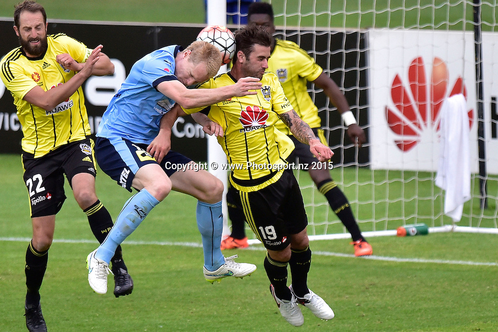 Thomas Doyle (R of the Phoenix jumps for the ball with Mathew Simon of Sydney FC during the A-League - Wellington Phoenix v Sydney FC football match at Westpac Stadium in Wellington on Sunday the 19th of December 2015. Copyright Photo by Marty Melville / www.Photosport.nz