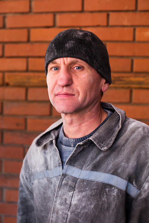 A mine worker poses for a portrait at Zasyadko Mine on March 7, 2015 in Donetsk, Ukraine. These workers were required to come in on an off day to help unload sugar and flour from a humanitarian aid convoy that arrived in Donetsk from Russia.