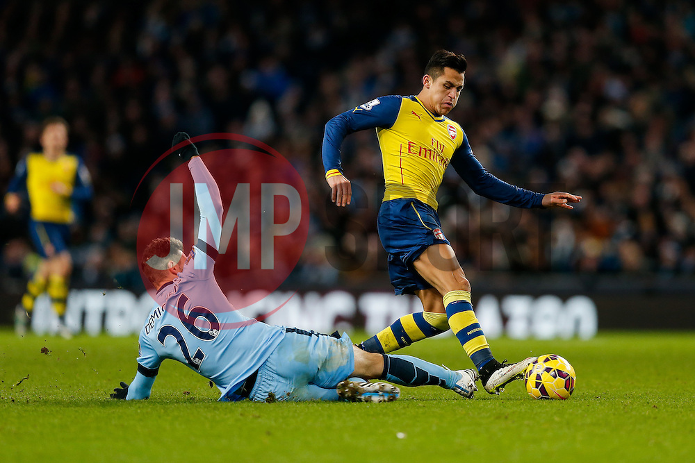 Alexis Sanchez of Arsenal is challenged by Martin Demichelis of Manchester City - Photo mandatory by-line: Rogan Thomson/JMP - 07966 386802 - 18/01/2015 - SPORT - FOOTBALL - Manchester, England - Etihad Stadium - Manchester City v Arsenal - Barclays Premier League.
