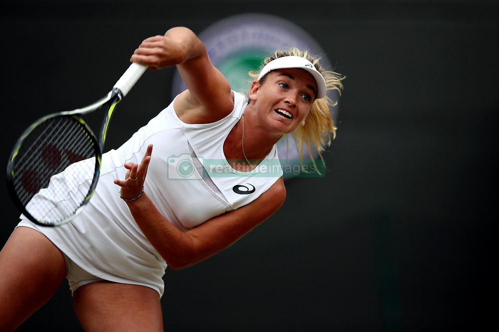 Coco Vandeweghe in action against Magda Rybarikova on day eight of the Wimbledon Championships at The All England Lawn Tennis and Croquet Club, Wimbledon.