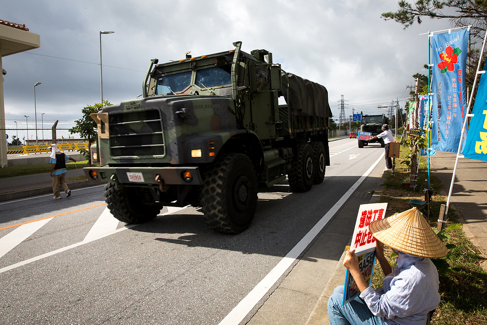 OKINAWA, JAPAN - NOVEMBER 14:  Anti U.S. Base protesters sit in the road with their placards in front of the gate of U.S Marine Base in Camp Schwab, protesting against the construction of the new U.S base in Henoko, Nago, Okinawa prefecture, Japan on November 14, 2015. (Photo: Richard Atrero de Guzman)