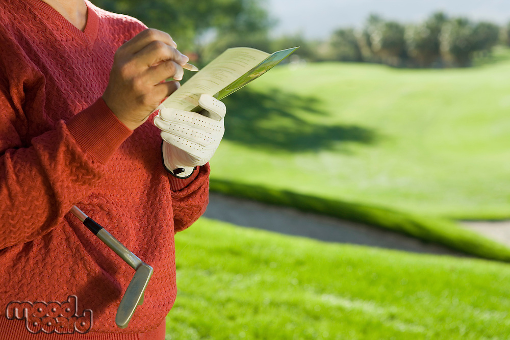 Golfer Writing in Scorecard