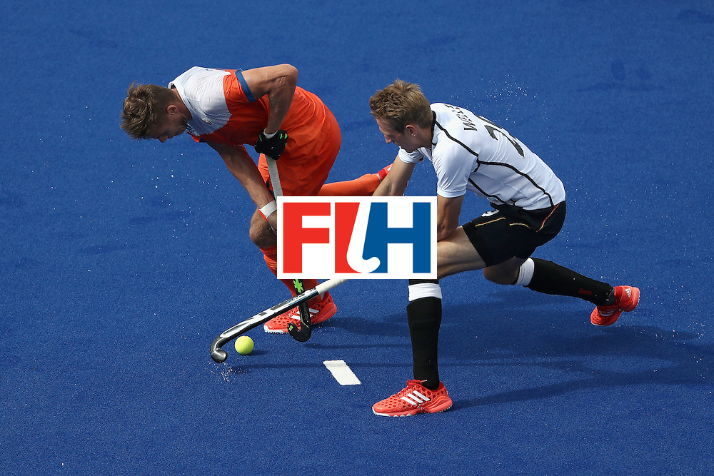 RIO DE JANEIRO, BRAZIL - AUGUST 12:  Sander de Wijn #12 of Netherlands battles with Niklas Wellen #29 of Germany during a Men's Preliminary Pool B match on Day 7 of the Rio 2016 Olympic Games at the Olympic Hockey Centre on August 12, 2016 in Rio de Janeiro, Brazil.  (Photo by Sean M. Haffey/Getty Images)