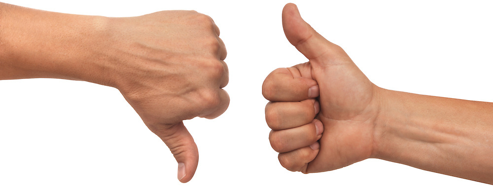 two male hands with thumbs up and down on white background