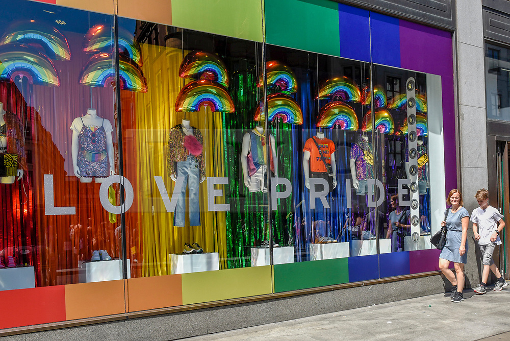 © Licensed to London News Pictures. 29/06/2018. LONDON, UK.  Top Shop joins other stores in the Oxford Street area receiving a rainbow makeover in support of the Pride Festival, a worldwide celebration of the LGBT community.  The popular annual Pride London parade takes place in the capital on 7 July.  Photo credit: Stephen Chung/LNP