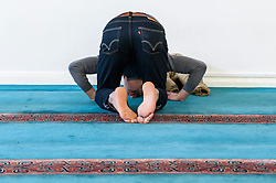 "© Licensed to London News Pictures. 07/02/2016. London, UK.  A worshipper in the prayer room.  The East London Mosque & London Muslim Centre, in the heart of Tower Hamlets, and home to the UK's largest Muslim community, opens its doors as part of ""Visit My Mosque Day"", a national initiative facilitated by the Muslim Council of Britain, where mosques across the UK organise open days to allow the British public to see what goes on in a mosque and to understand its role in Muslim life.  The aims are ""to reduce the 'unknown' or 'fear' factor for members of the British public with their local mosque and Muslim communities"". Photo credit : Stephen Chung/LNP"