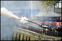 A gun Salute is fired as Boats take part in the  Royal Pageant with a flotilla of a 1,000 boats accompanying The Queen and the Royal Family down the Thames to mark the Queen's Diamond Jubilee. Sunday June 3, 2012 Photo by Andrew Parsons/i-Images