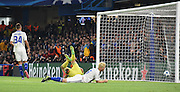 A dejected Aleksandar Dragovis lies on the floor after slotting home and own goal during the Champions League group stage match between Chelsea and Dynamo Kiev at Stamford Bridge, London, England on 4 November 2015. Photo by Michael Hulf.