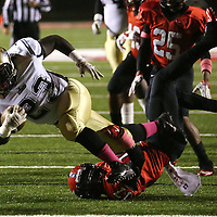 Lauren Wood | Buy at photos.djournal.com<br /> Amory's Monzavier Latham is tripped up by Corinth's Dee Brown during Friday night's game at Corinth.